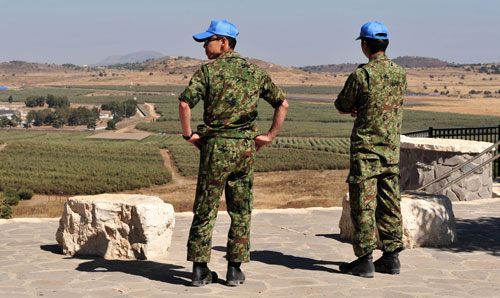 UN Peacekeepers looking out over a vista