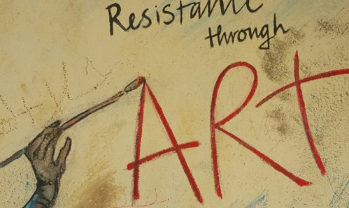 A drawing of 'Resistance through ART' painted on a wall
