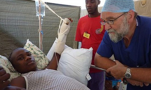 Tony Redmond caring for victim of earthquake in hospital setting